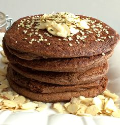 Vegan, gluten free pancakes made with banana, zucchini, unsweetened cocoa powder & flaxseed. These 80 Calorie Zucchini Cocoa Pancakes make a perfect low calorie breakfast while adding more greens to your diet.