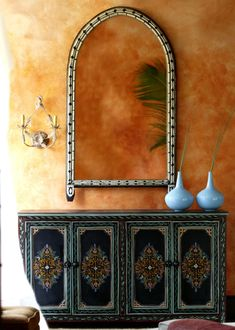 Tadelakt earthy walls, Camel bone mirror, beautiful pottery and a pretty dresser. Moroccan home decor. Morrocan Decor, Moroccan Furniture, Moroccan Interiors, Moroccan Mirror, Mosaic Furniture, Moroccan Lanterns, Moroccan Design, Moroccan Style, Moroccan Lounge