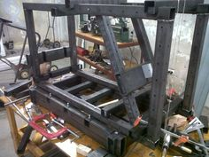Motorcycle Frame Jig by billyfly -- Homemade motorcycle frame jig fabricated from rectangular tubing and steel plate. Tabletop-mounted for ready accessibility. http://www.homemadetools.net/homemade-motorcycle-frame-jig-2