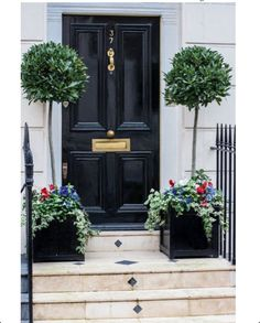 Need to repaint front doors black!!!.....from Enchanted Home Blog