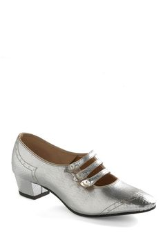 Although these are from the 60s, they look very much like what I would have imagined Dorothy's silver slippers to look like.