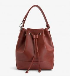 d1531b09b469 Bucket bag that can be worn crossbody or on shoulder with extendable strap.