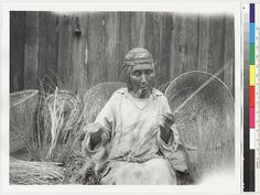 Karuk woman peeling Willow shoots to make baskets - 1930