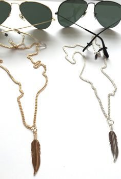 Fashionable eyewear chain and Feather Backlace. Sunglass and eyewear protection that makes a fashion statement with a Feather Charm that hangs down the back. Surf Necklace, Pendant Necklace, Eyeglasses, Eyewear, Jewelery, Earrings, Money, Flare, Christopher Columbus