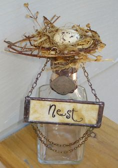 Nest. {way to display the old bird nests I find; can buy faux eggs or make them out of sculpy}