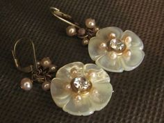 Vintage mother of pearl button earrings. $20.00, Follow D. Wallace Designs on Facebook to purchase earrings.