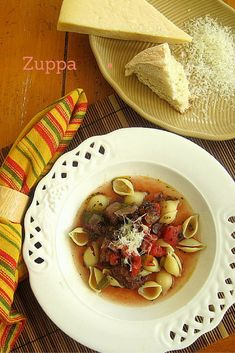 An easy fix, the hardest part is giving up a cup and a half of good red wine to simmer in the broth. Sweet and hot Italian sausage long simmered in beef stock, and tomatoes, seasoned with green bell pepper, garlic, onion and basil makes for an incredibly flavorful treat. Ladle over large shell pasta and top with shredded Parm finishes this soup.  You really must give this one a try.