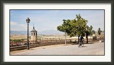Framed Print Avila Spain with Bicycle.  Blue skies and beautiful overlook into the hills of Castilla Leon, Spain.  Home decor of european scenes.  Europe travel photography in blue, cream, green.