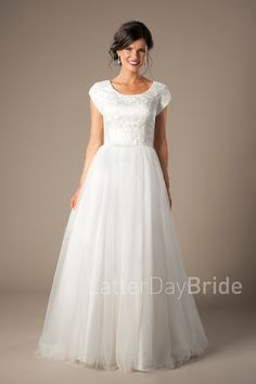 Ashley   Modest Wedding Dress   LatterDayBride   Worldwide Shipping     This simple, elegant bridal gown features a light lace bodice and a gathered tulle A-line skirt.    Gown available in Ivory or White     *Pictured in Ivory    Sleeve length or neckline can be customized.