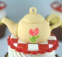 Hi everyone! Today I'm going to show you how to make a cute teapot cupcake topper. Perfect if you're going to going for a tea party themed party. This is what I use: Fondant/Marshmallow Fondant (an alternative is to use gum paste) in ivory, white and red Gel food color in pink and green Ball …
