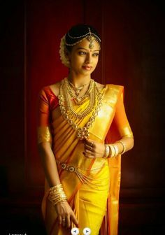 South Indian bride. Gold Indian bridal jewelry.Temple jewelry. Jhumkis. Yellow silk kanchipuram sari.Braid with fresh flowers. Tamil bride. Telugu bride. Kannada bride. Hindu bride. Malayalee bride.Kerala bride.South Indian wedding.