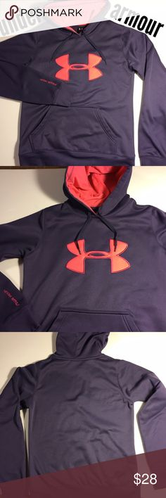"""UNDER ARMOUR Hoodie Hooded Sweatshirt XS like new! This under armour hoodie has a front pouch pocket, drawstring hood (the tips on drawstrings bear a tiny under armour logo!), soft fleecy lining. Large pink logo on front, hood is lined in pink. Hoodie is muted royal blue- kind of a cornflower or purplish blue shade. Shell is 100% poly, hood lining is 95 poly, 5 elastase for a nice fit. Banded hem & sleeve cuffs. Excellent like new condition. Underarm to bottom of hem is 17"""". Size XS. (#208)…"""