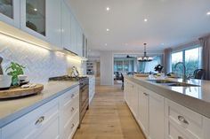 We love a tiled splashback in herringbone lay for Classic Hamptons