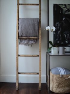 I would love this painted black in the living room for a blanket rack!!!