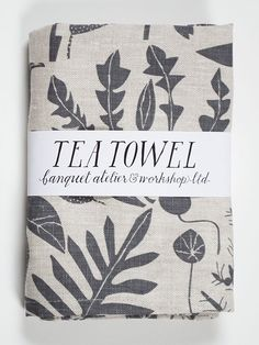 Soft charcoal houseplants screen printed on our natural 100% linen tea towel: conceived, screen printed and sewn in Canada. water based inks screen...