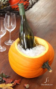 Pumpkin Ice Bucket Idea. Use the pumpkin after you scoop it out for the pie. Such a unique table decoration