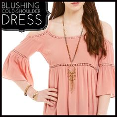 Blushing Cold-Shoulder Dress Blushing Cold-Shoulder Dress- this cold shoulder dress is a beautiful dark blush color (color is best represented in the covershot.) it is roomy and comfortable. It's right on-trend with the cold should and bell sleeve. Boutique Dresses