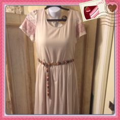 Beautiful feminine new maxi dress! Soft pink/hard to describe color. The sleeves and bottom have a burgundy print. Bought from fellow posher. To tight for me. I love this dress. Belt not included. Rhythm Dresses Maxi