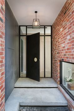 Tagged: Doors, Exterior, Metal, and Swing Door Type. Photo 4 of 12 in A Progressive Melbourne Development Company Helps Facilitate an Exquisite Home Renovation. Browse inspirational photos of modern doors and entryways. House Design, Entrance Design, Exterior Design, Red Brick House, Brick Exterior House, Home, House Entrance, Exterior Brick, House Exterior
