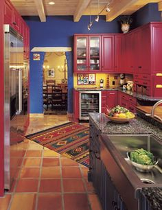 Southwest / Mexican kitchen design - love the rug on the tile floor
