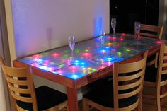 """Dining table with a frosted glass top lit by 448 LEDs that respond, in  a complex and gentle fashion, to input generated by motion above the  table while we eat.""---a someday craft for me on a smaller scale!"