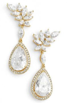 So glamorous! A mix of marquise-shaped cubic zirconias adds graceful movement to these elegant drop earrings plated in precious metal.
