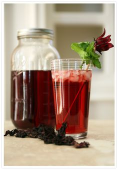 Agua de Jamaica: 2 cups dry jamaica/hibiscus flowers,3/4 cups raw sugar, 6 cups water, Ice, Mint leaves (optional)