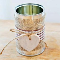 Although this is for a Wedding table decoration, Substitute green or red gingham and a paper tag (name) for Christmas - CUTE!