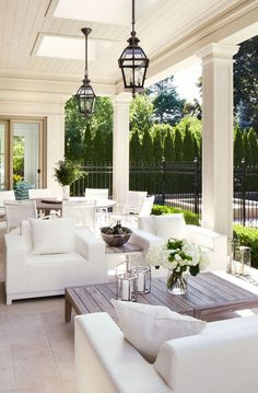 Hepfer chose natural pieces for the backyard loggia, from the travertine tile floors to the simple white chairs by Jardin de Ville, to complement the gorgeous garden views.