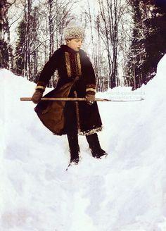 Tsarevich Alexei Romanov of Russia (1904-1918) out shoveling the snow.