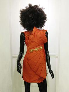 Mini party dress with asymmetric drape detail and bronze embellishment by Rani Patrice