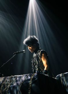 Prince on stage at Manchester Academy, January 2014