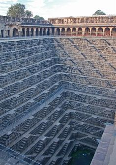 Chand Baori Step Well - Chand Baori is a famous stepwell situated in the village Abhaneri near Jaipur in Indian state of Rajasthan. This step well is located opposite Harshat Mata Temple and is one of the deepest and largest step wells in India. It was built in 9th century and has 3500 narrow steps and 13 stories and is 100 feet deep. It is a fine example of the architectural excellence prevalent in the past.