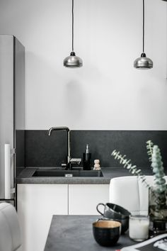 a Scandinavian space with a concrete countertop and backsplash that spruce up usual white cabinets Kitchen Backsplash, Kitchen Countertops, Diy Kitchen, Kitchen Decor, Open Kitchen, Black Kitchens, Home Kitchens, American Kitchen Design, Modern Kitchen Interiors