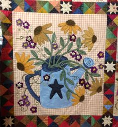 My finished Watering Can block. Pattern from Primitive Gatherings titled: A Primitive Garden. Block made by Rhonda Dort