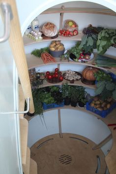 Ground fridge cools raw goods without electricity!  Innovative invention that may fit your needs.  Risingbarn.com