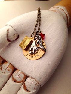Cinder necklace lunar chronicles book by ManandDogDesigns on Etsy