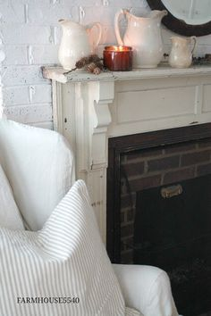 Old fireplace mantel against s painted brick wall. Fixer Upper Bedrooms, Fixer Upper Living Room, Farmhouse Fireplace Mantels, Old Fireplace, Fireplace Ideas, Country Farmhouse Decor, Farmhouse Style, White Farmhouse, Farmhouse Pitchers