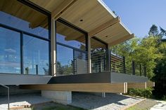 Home & Apartment, Balcony Modern Forest House Design With Glass Window Sliding Door Wooden Ceiling And Cable Wire Railing Ideas: Mesmerizing Whidbey Island Cabin by CHESMORE|BUCK Architecture
