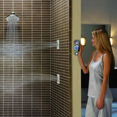 Much like modern push-to-start car technology, the Moen ioDIGITAL shower can be turned on with the simple push of a remote control button—all from the comfort of your warm bed on a chilly morning. Digital Showers, Double Shower, Home Gadgets, Tech Gadgets, Warm Bed, Luxury Shower, Smart Home Technology, Shower Time, Home Automation