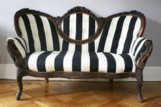love the match of the Victorian sofa with the modern bold stripes