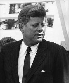 Image Date: 9/24/1963 Image Title: [Pinchot Institute dedication.] Image Caption: President John F. Kennedy. [President John F. Kennedy standing on stage, Pinchot Institute dedication ceremony at Grey Towers, Pennsylvania.]