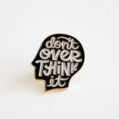 DON'T OVERTHINK IT enamel pin<ul>  <li>die struck enamel pin</li>  <li>1 inch tall</li>  <li>black and white design on gold metal pin back</li