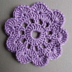 Crocheted Big Flower-coaster Free PDF Pattern - http://crochet-land.com/wp-content/uploads/2010/12/Crocheted-Big-Flower-coaster.pdf