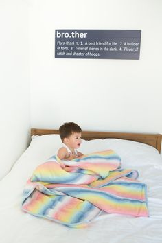 Cotton Cloud Kid's quilt, Ombre Rainbow stripe.  Brighten up your child's room with this fun quilt. #henryandbros