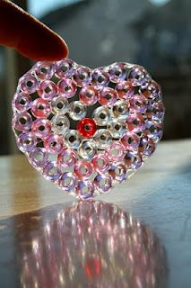 Pony Bead sun catchers. Plastic cookie cutters, elmer's glue. Put heavy book on top for one day to allow outer edges to dry, then remove and inside will dry. Put on wax paper. Remove cookie cutters by gently twisting. Use suction cups and wire to hang.