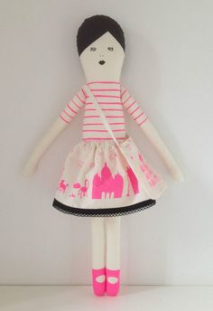 This is a kit to make your own fabric I love Paris doll,  Each pack contains:    - 2 pieces of screenprinted cotton to make the doll, neon pink