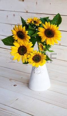 Sunflowers in a vase on a rustic, gray background photo