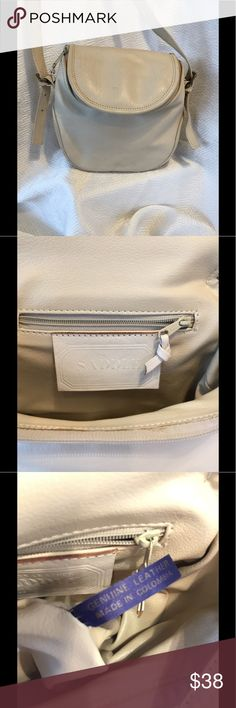 Cream leather saddlebag, cross body Very good used condition on this saddle bag.  Cream colored, strap in excellent condition, no splitting, zippers all work no other defect, lining no spots whatsoever.  No pets/smoke closet, lots of life left! Sabina Bags Crossbody Bags