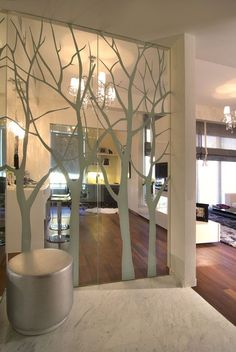 Tree on a Glass Wall in a Beauty Saloon, glass partition with graphic overlay -- allows for degree of privacy while keeping visual connection.
